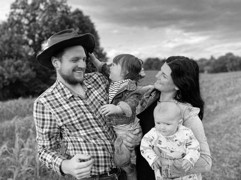 Josh and family in black and white